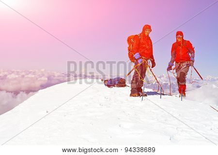 hikers at the top of a pass