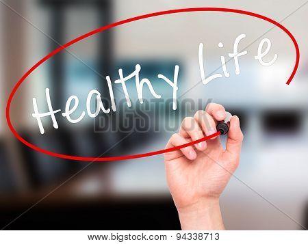 Man Hand writing Healthy Life black marker on visual screen.