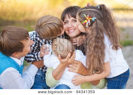 Large Family Hugging And Having Fun