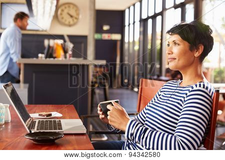Woman drinking coffee, side view