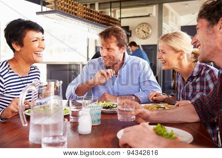 A group of friends having lunch in a restaurant