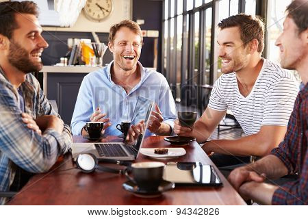 Men talking at a coffee shop