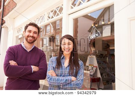 Couple standing in front of a shop window