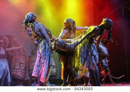 KRAKOW POLAND - JUNE 20 2014: The night of the Music on Szczepanski Square in Cracow. Slavic Prelude perfomed by WATAHA Slavic Drummers and Art Color Ballet shows to the modern viewer colorfull archetype of the Slavic world full of magic