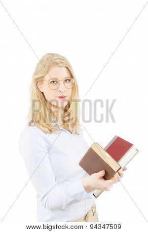 Beautiful young blond female student holding books