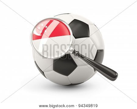 Football With Magnified Flag Of Singapore