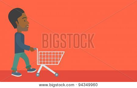 A handsome black guy pushing an empty cart. A Contemporary style with pastel palette, orange tinted background. Vector flat design illustration. Horizontal layout with text space in right side.