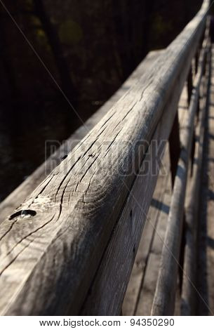 Wooden Bridge Handrail Diagonal Shot With Dark Water Background