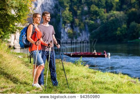 Man and woman hiking at Danube river in summer, Weltenburg narrows, for better fitness