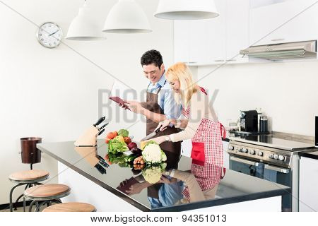 Asian couple cooking in stylish and modern kitchen