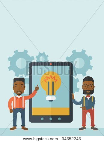 A two african businessmen standing while holding a big screen tablet with bulb icon a computer tablet perspective view strategy marketing. Business concept. A Contemporary style with pastel palette