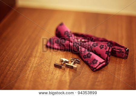 Bow Tie And Cufflinks On Table