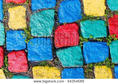 Old Painted Cobblestone Background With Grass