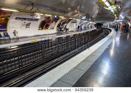 Parisian Subway Station With Passengers
