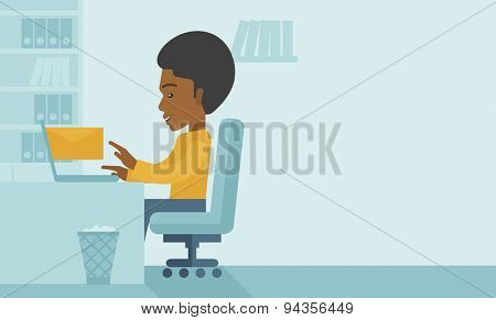 Young happy african man sitting in front of a table with computer laptop and thinking what to write in e-mail inside his office. A Contemporary style with pastel palette, soft blue tinted background