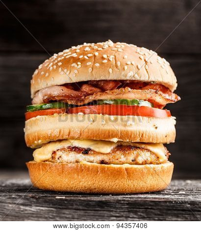 Double burger with chicken, bacon and vegetables