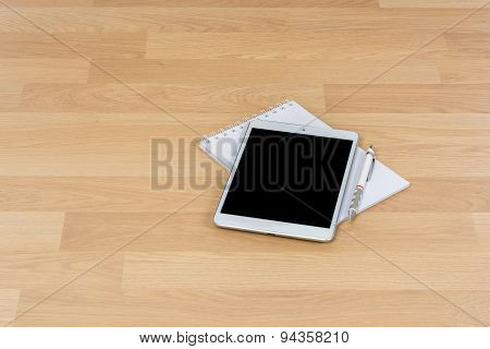 White Digital Tablet On Wooden