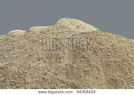 Pile of natural unsifted dirt with small pebbles and stones embedded - isolated on a blue backgroun