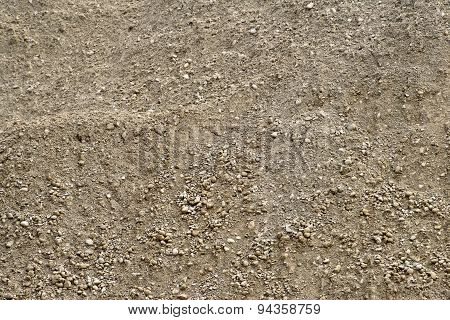 Close up of unsifted natural dirt with small stones