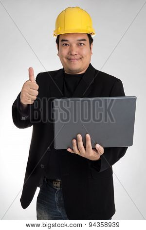 Portrait Of Asian Smiling Holding Laptop With Safety Helmet