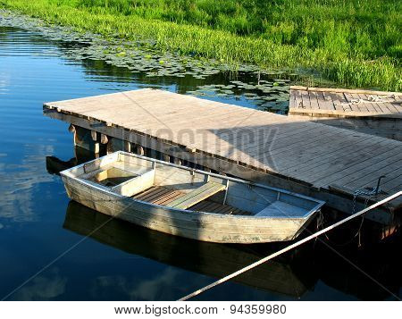 Wooden Boat On The River Wharf On A Lovely Summer Day