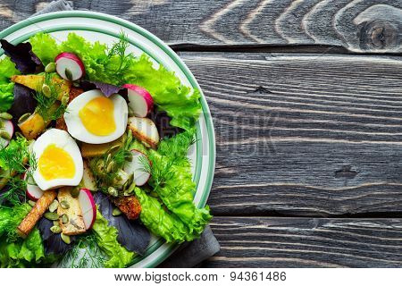 Potato salad with egg, radish, basil and pumpkin seeds