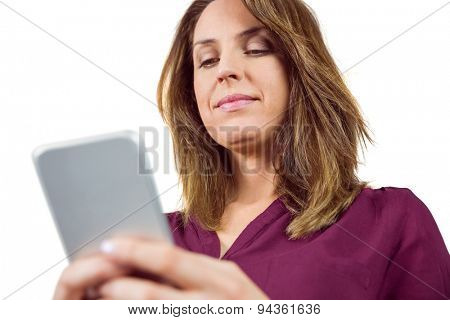 Pretty brunette sending a text message on white background