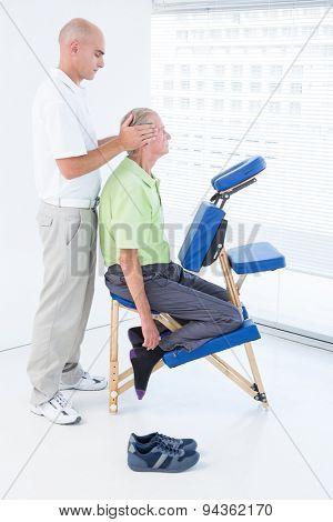 Man having head massage in medical office