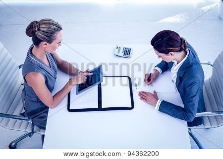 Businesswomen working together at desk in the office