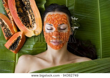 Beautiful Woman Having Fresh Papaya Facial Mask Apply. Fresh Papaya
