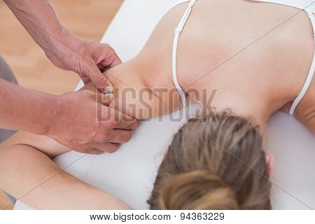Physiotherapist doing arm massage to his patient in medical office