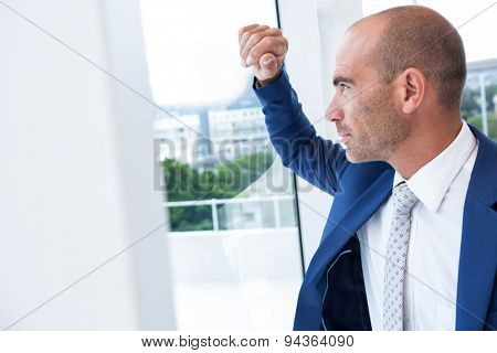 Serious businessman looking away in the offie