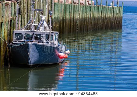 A lobster fishing boat tied up at the wharf in Hall's Harbour, Nova Scotia.