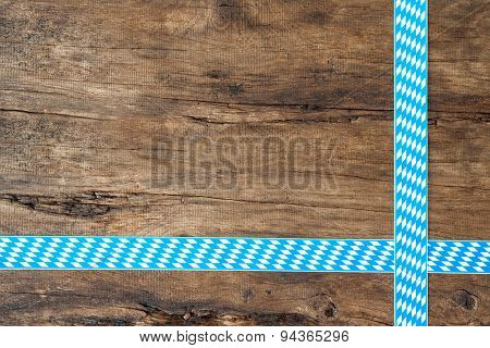Rustic background for Oktoberfest with bavarian white and blue ribbon