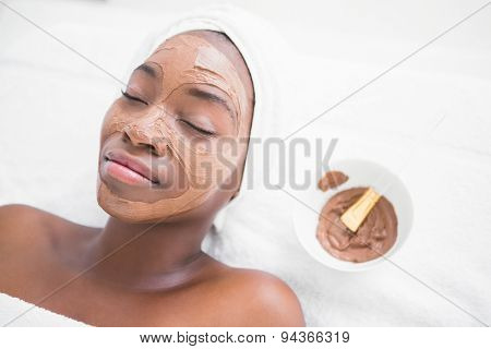 Pretty woman enjoying a chocolate facial treatment at the health spa