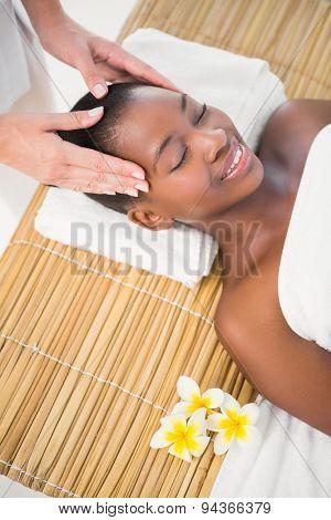 Pretty woman enjoying a head massage at the health spa