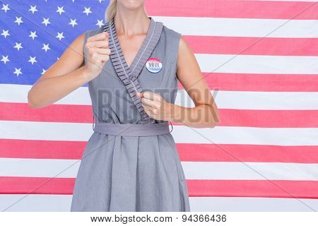 Composite image of blonde woman motivating for electoral campaign