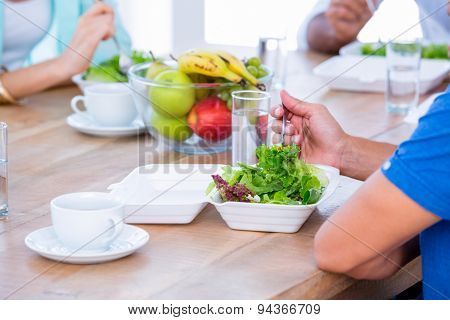 Group of friend eating together in living room