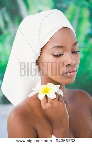 Close up a beautiful young woman with flower over a white background