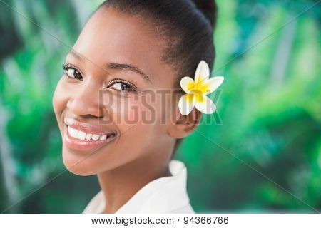 close up a beautiful young woman with flower in her hair over white background
