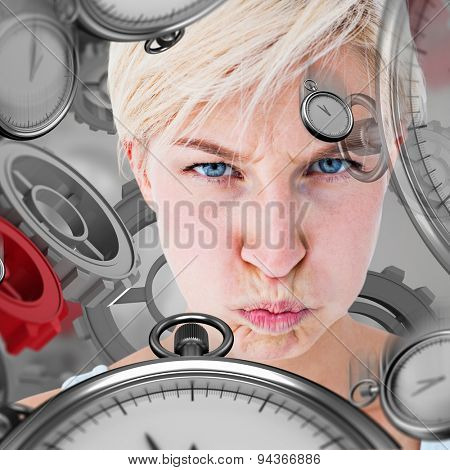 Angry woman looking at camera against grey vignette