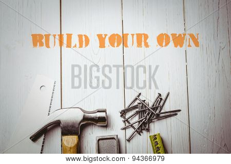 The word build your own against desk with tools