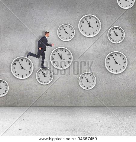 Businessman running against grey room