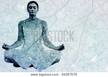 Peaceful woman in white sitting in lotus pose against branches and leaves