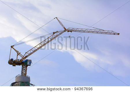 Tower cranes are a modern form of balance crane that used in the construction of tall buildings.