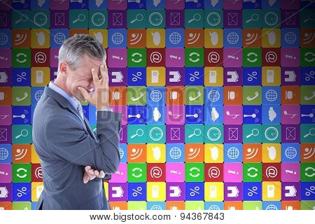 Businessman with headache against app wall