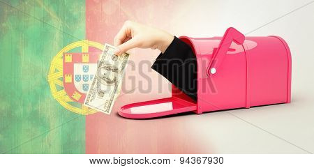 Businesswomans hand holding hundred dollar bill against portugal flag in grunge effect