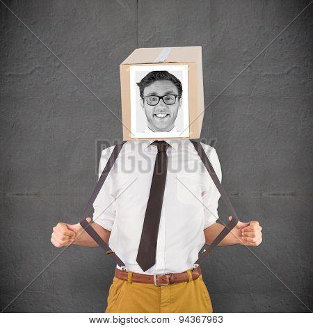 Businessman with photo box on head against grey concrete tile