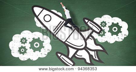 Flying businessman against green chalkboard