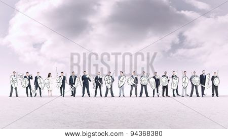Corporate army against cloudy sky background
